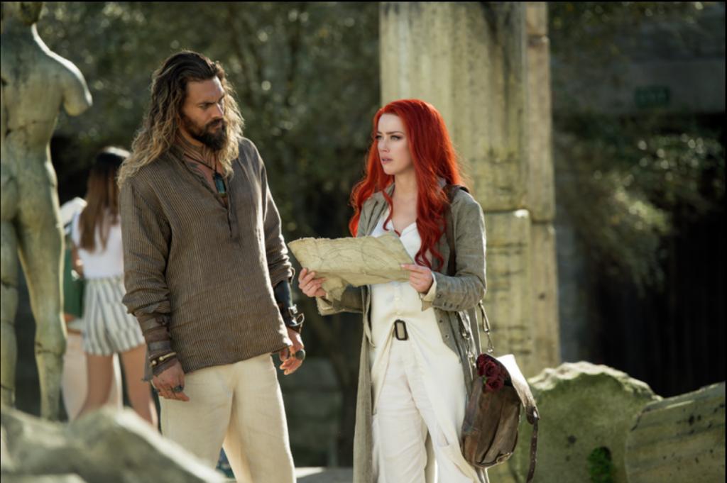 JASON MOMOA as Aquaman and AMBER HEARD as Mera in Aquaman