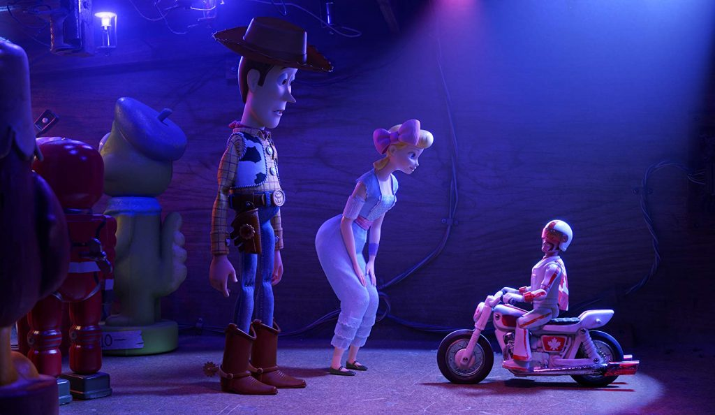 Tom Hanks as Woody, Annie Potts as Bo Beep and Keanu Reeves as Duke Caboom in Toy Story 4 Disney/Pixar.