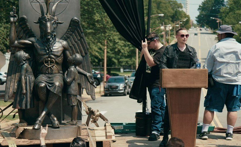 Loud and Clear reviews Hail Satan documentary Netflix Sundance statue